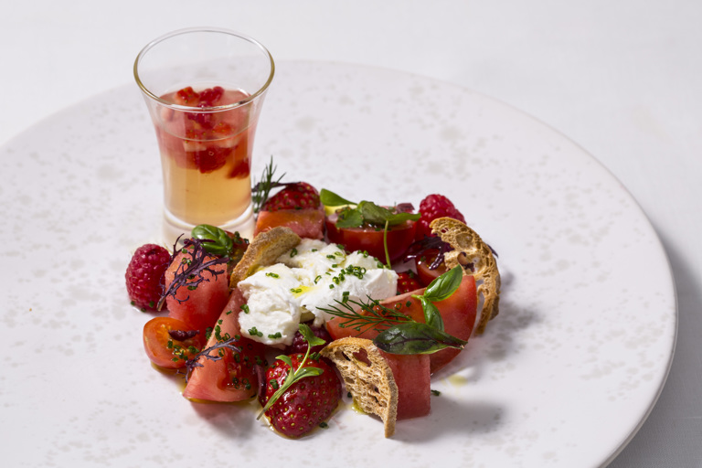 Tomato and berry salad with tomato water, watermelon and chives