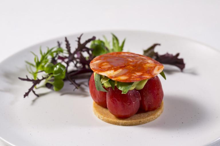 Plum tomato tart with Parmesan pastry, avocado and chorizo