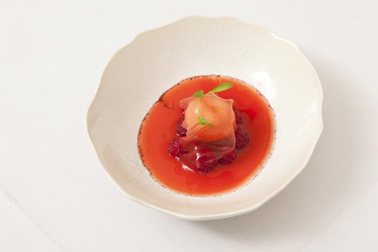 Raspberry soup with raspberry jelly and milk ice cream
