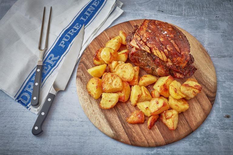 Lemon and fennel slow cooked pork shoulder with roast potatoes