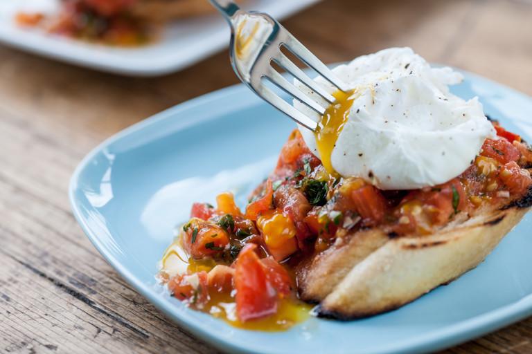 Plum tomato bruschetta with poached eggs