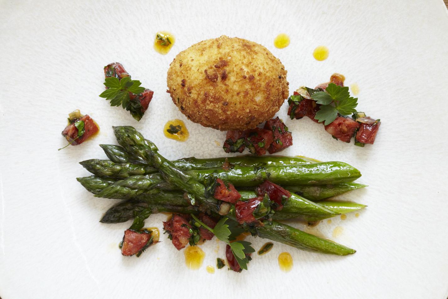 Asparagus with crispy duck egg, chorizo and lovage