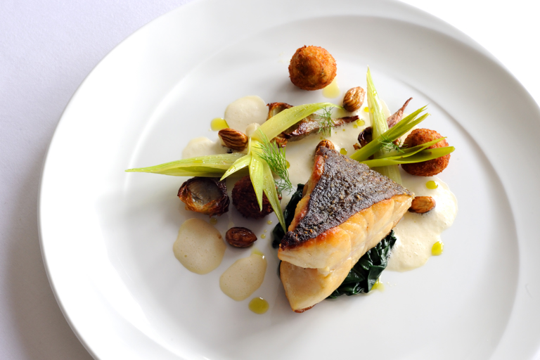 Pan-roasted turbot cooked on the bone with fennel croquettes and Pernod velouté