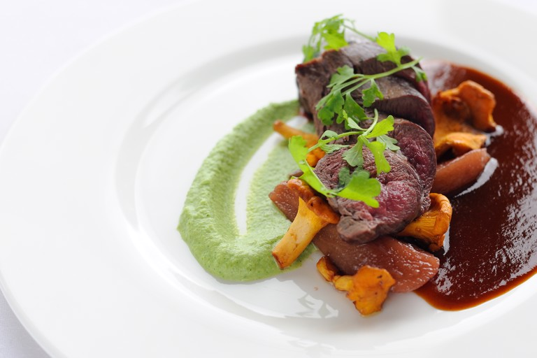 Loin of venison with broccoli and stilton purée and red wine sauce