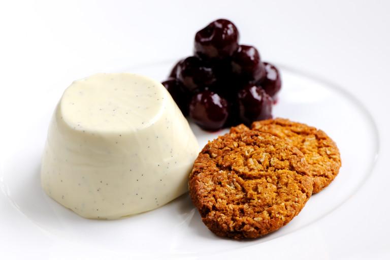 Cherries jubilee with vanilla and yoghurt panna cotta