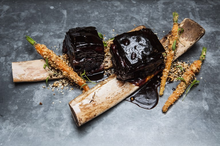 Braised beef short rib in a dark and light soy marinade with soy pickled carrots and crushed peanuts