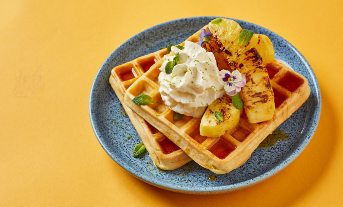 Coconut and lime waffles with caramelised pineapple