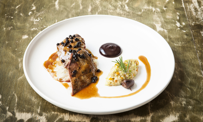 Roast Yorkshire grouse with creamed root vegetables, stuffed cabbage and elderberries