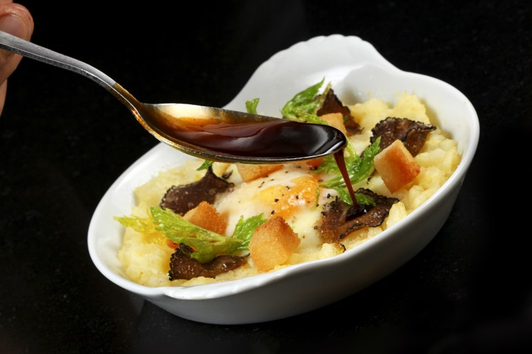 Baked hen's egg with crushed celeriac, truffle and croutons