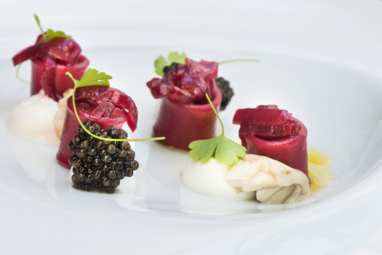 Beetroot pasta, red onion, yoghurt and caviar