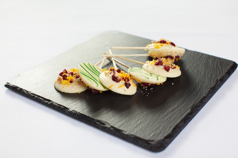 Mandarin scented white chocolate and cranberry lollipops