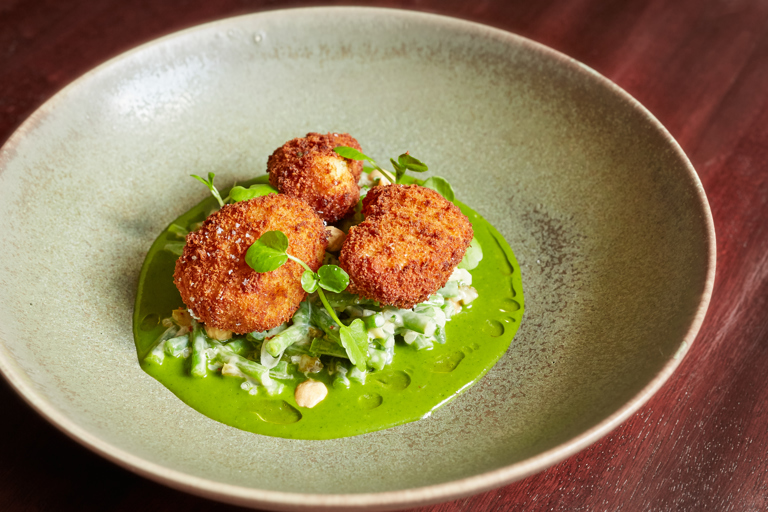 Berkswell-crusted sous vide sweetbreads with green bean salad and watercress velouté