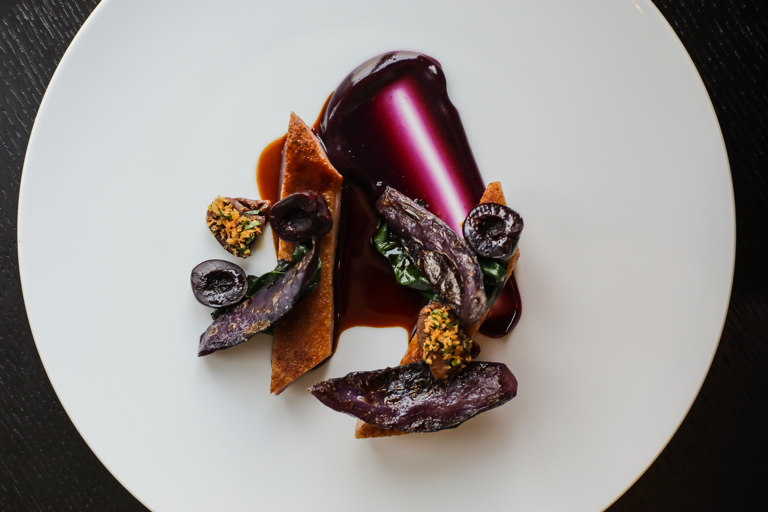 Powdered duck with braised cabbage and pickled cherries