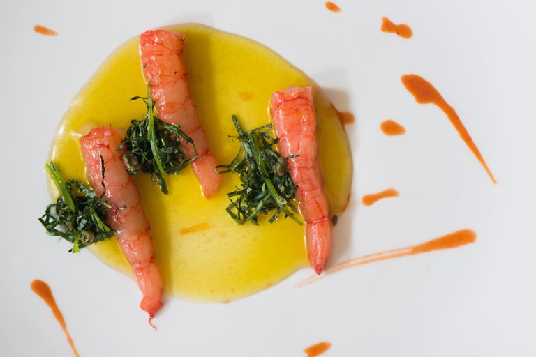 Red prawns from Porto Santo Spirito, lemon and honey emulsion and marinated cavolo nero