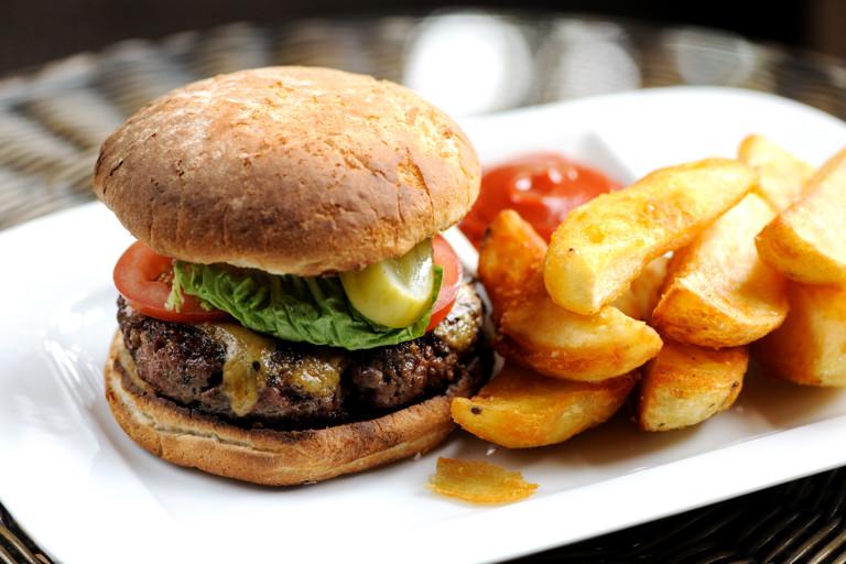 Homemade beef burger with Stilton rarebit, burger sauce and chunky chips