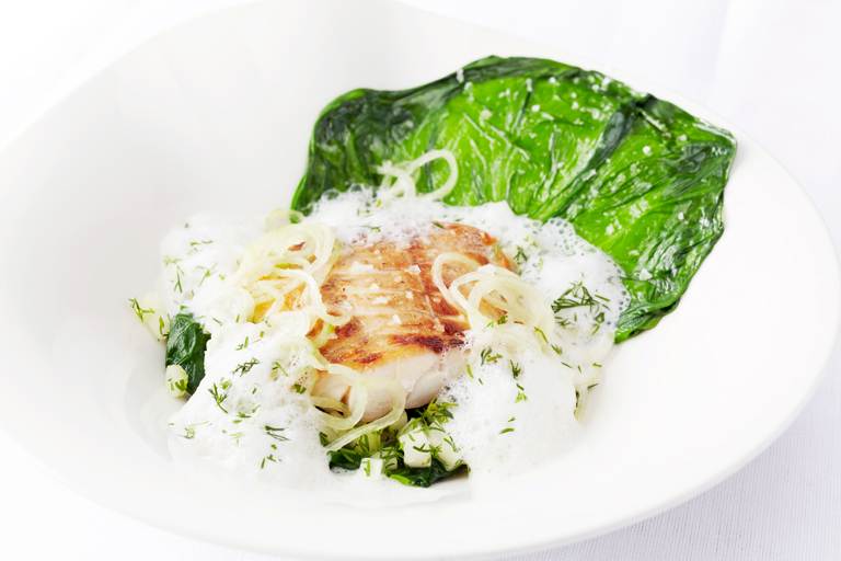 Pan-fried sea bass fillet and mousseline raviolo, steamed lettuce and cucumber