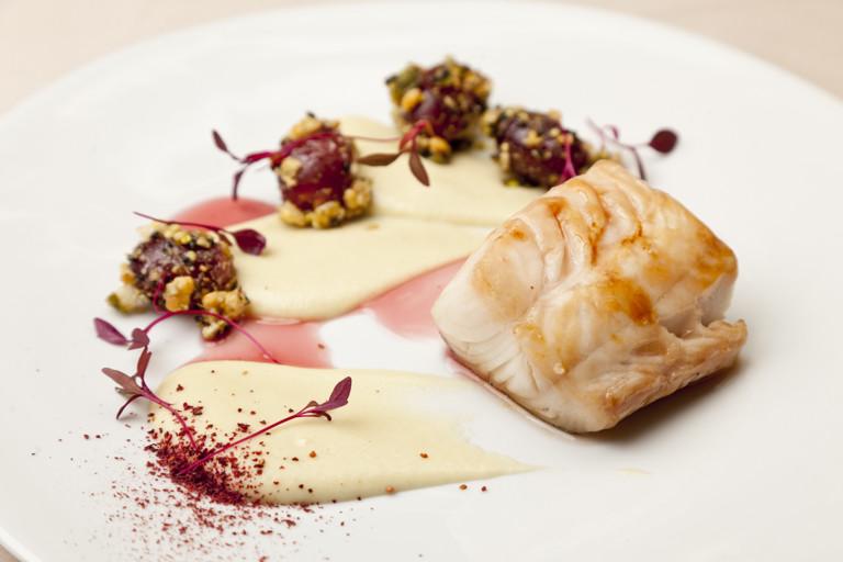 Glazed Alaska black cod with a verjuice sauce and crunchy grapes