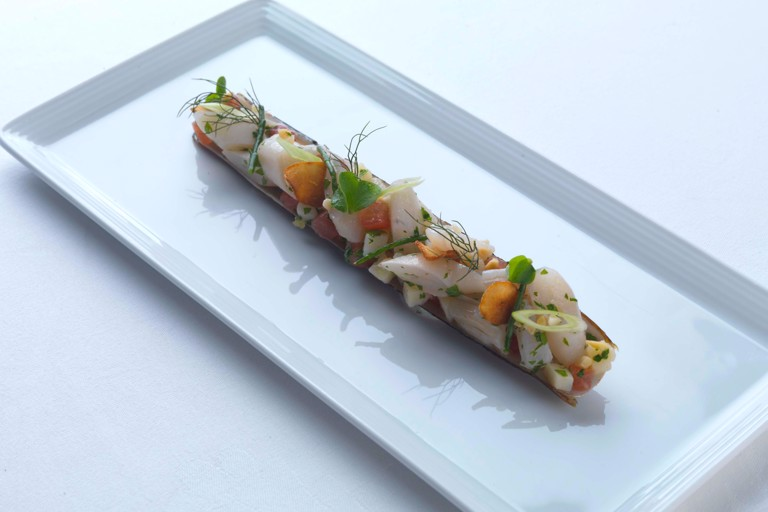 Razor clams with spring onions and almond