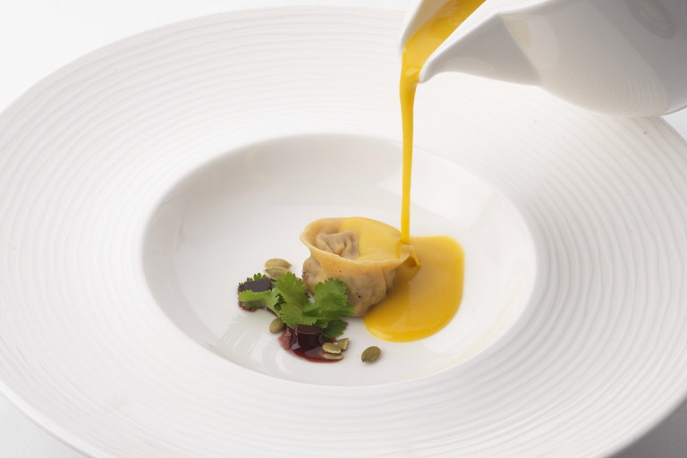 Duck confit tortellini with butternut squash velouté and soya jelly