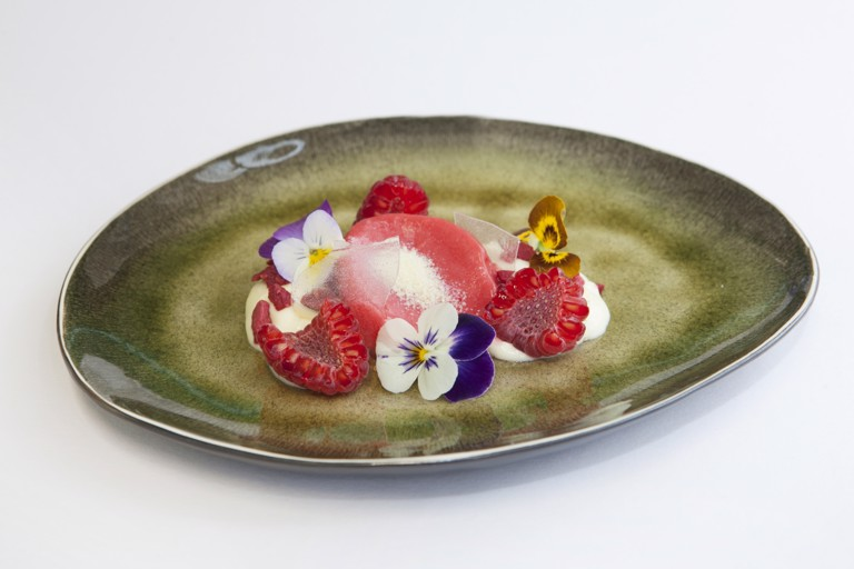 Raspberries with violet and oatmeal