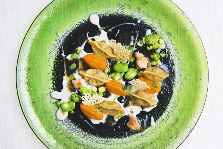 Rabbit ravioli with Ragusano cheese, carrot, broad beans and peas