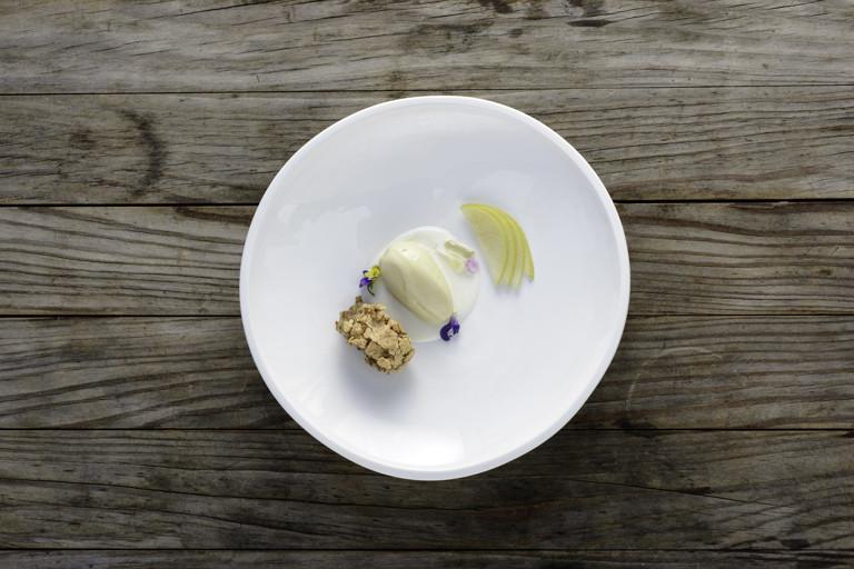 Honey ice cream with kefir, walnut meringue and summer pears
