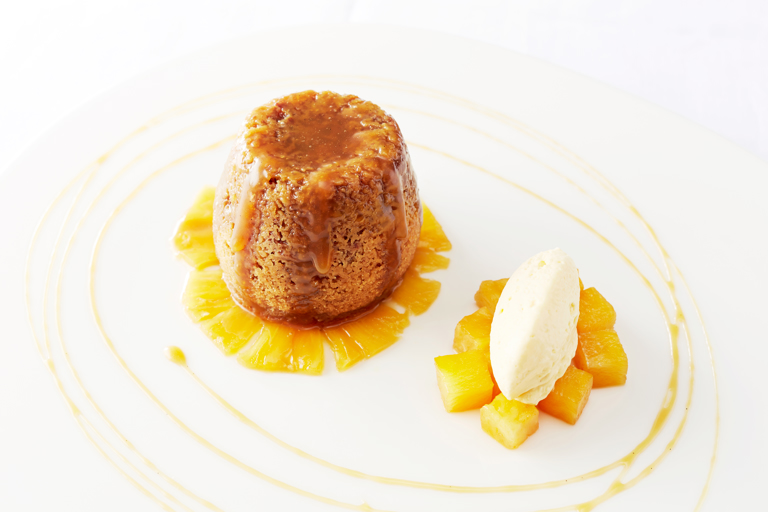 Sticky ginger pudding, marinated pineapple, mango cream and ginger beer syrup