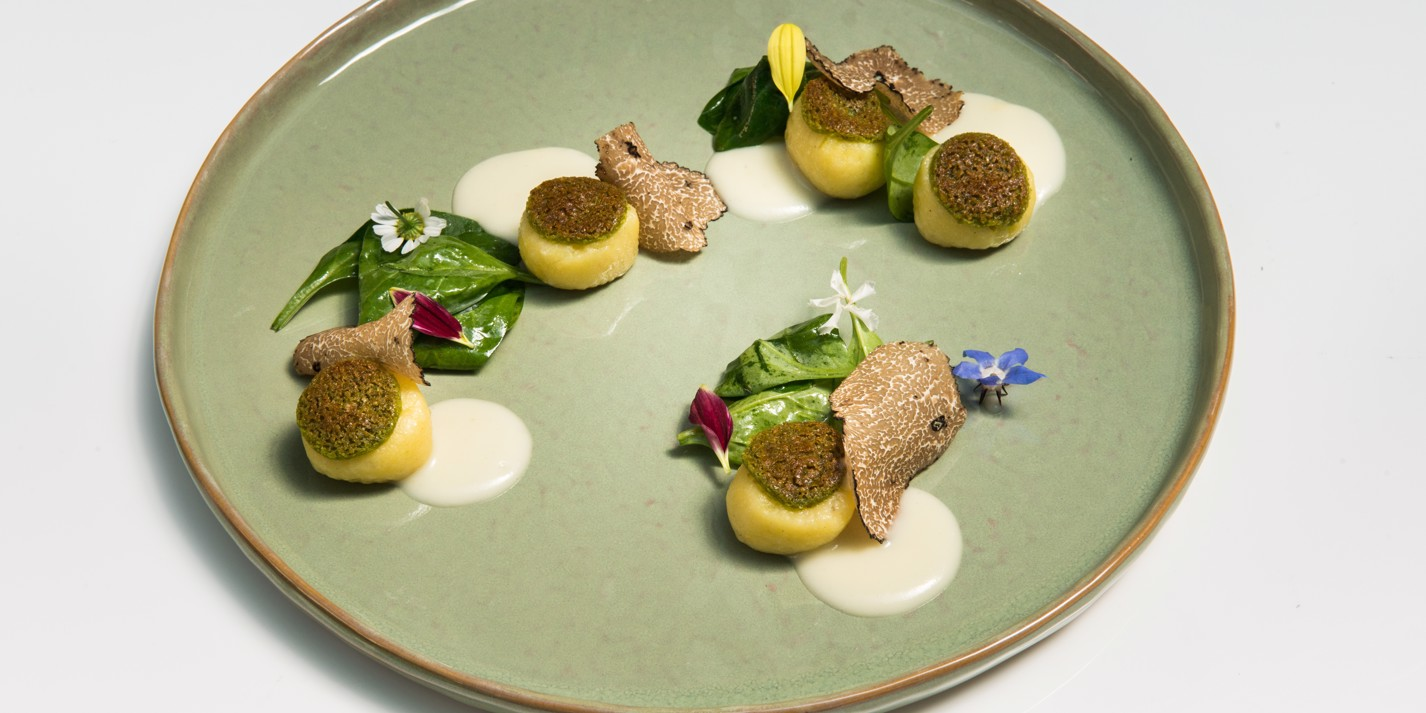 Grated gnocchi with herbs, garlic sauce and black truffle