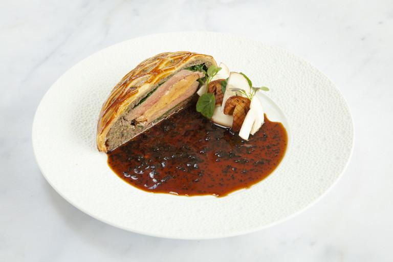 Anjou pigeon, cepe and foie gras en croute with black truffle sauce