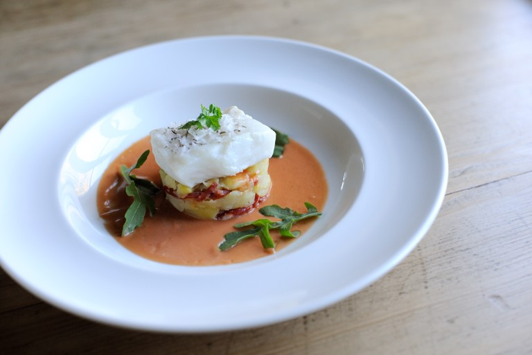 Salted cod with crushed potatoes, chorizo, tomato and thyme vinaigrette