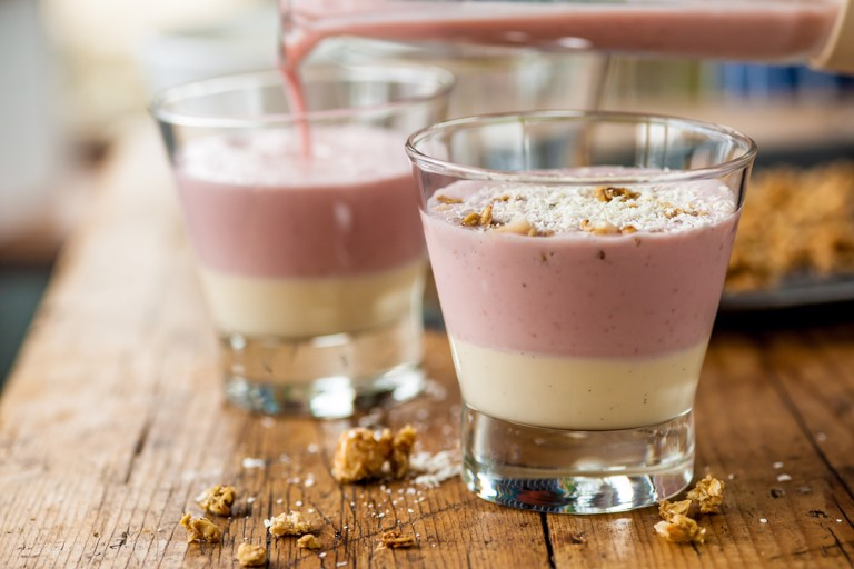 Rhubarb smoothie topped with custard and granola