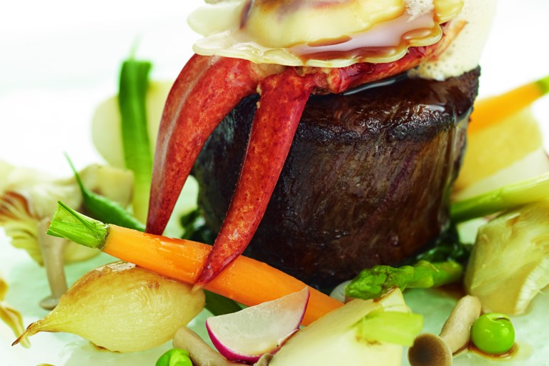 Jersey beef fillet with St Ouen's Bay lobster ravioli and summer vegetables