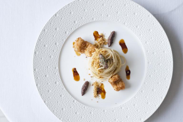 'Spaghetti con colatura di alici', walnut pesto and fried silver scabbardfish